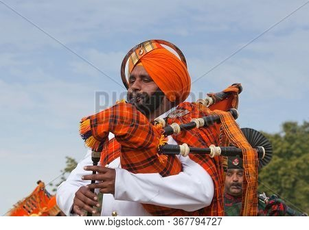 Indian Military Bagpipers Band Playing Bagpipe During Camel Festival In Rajasthan State, India