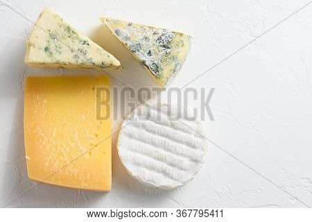 Cheese Platter: Yellow Maasdam, White Camembert And Blue Cheese Dor Blue On White Background. Copy S