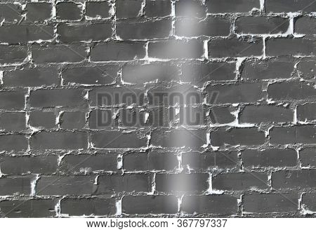 Number 1 On The Background Of A Black Brick Wall.