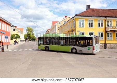Vaxjo, Sweden - June 26, 2018: A City Bus Turning At The Norra Jarnvagsgatan Street In City Center.