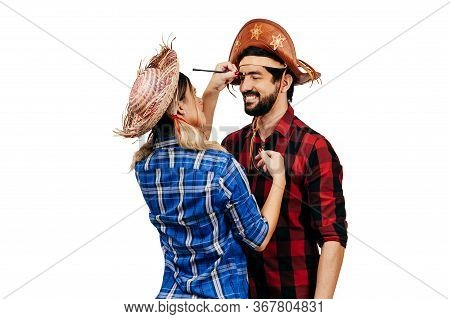 Brazilian Couple Wearing Traditional Clothes For Festa Junina - June Festival. Woman Putting Makeup