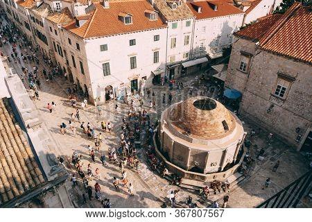 Dubrovnik, Croatia - 04 May 2016: Main Street Stradun Full Of Tourists Near Church Of St. Saviour An