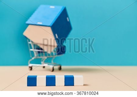 Property. Rent Or Sale Accommodation. Real Estate. Wooden Cubes With Copy Space. House Miniature In