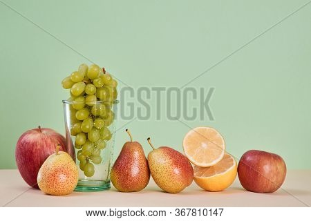 Diet Food. Healthy. Ripe Lemon Apple And Pear. Mellow Bunch Of Grapes. Summer Fruit. Copy Space. Gre