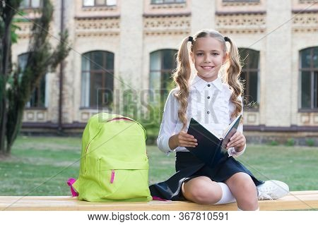 Reading Makes Her Smarter. Little Girl Read Library Book. Small Kid Enjoy Reading Outdoors. Beginnin