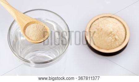 Organic Amla Powder With Water. Phyllanthus Emblica
