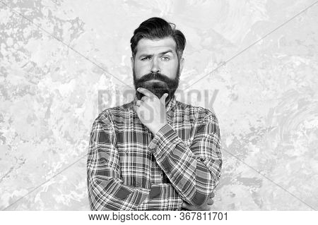 I Think So. Guy Hipster Outfit. Mature And Trendy. Masculine Traits. Brutal Bearded Man Concrete Bac