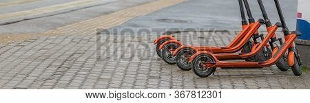 Electric Kick Scooters For Rent In City. Urban Modern Alternative Transportation And Technology Conc
