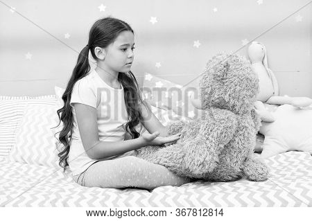 Communication. Favorite Toy. Girl Child Hug Teddy Bear In Her Bedroom. Pleasant Time In Cozy Bedroom