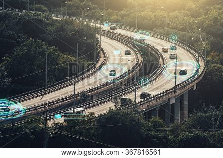 Autonomous Self Driving Cars Concept. Cars Move On City Road And Artificial Intelligence Controls Ve