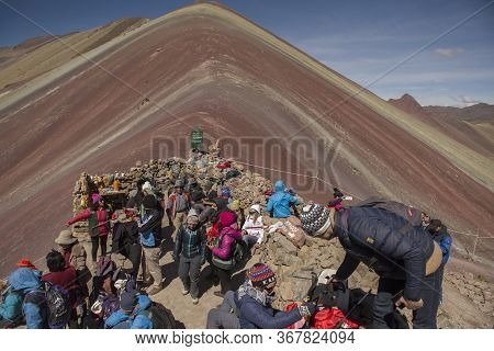 Vinicunca, Cusipata, Peru - June 08, 2017: Tourists Arriving In The Top Of Seven Colors Mountain, Or