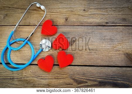 Heart Health And Red Heart With Stethoscope On Wooden Background / World Heart Day World Health Day