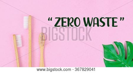 Zero Waste. Wheat Straw For Drinking Water With Green Leaves On Pink Background. Zero Waste Concept.