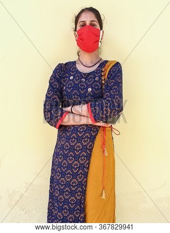 Photo Of A Young Beautiful Asian Girl Wearing Face Mask For Prevention From Coronavirus During Lockd