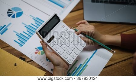 Close Up Of Bookkeeper Or Financial Inspector Hands Making Report, Calculating Or Checking Balance.