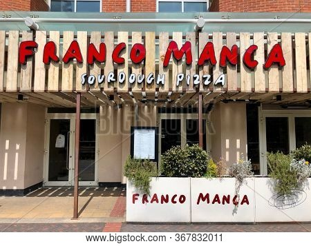 READING, UK - MAY 24, 2020: Outside a branch of Franco Manca, a chain of sourdough pizza restaurants, in Reading, Berkshire, UK.