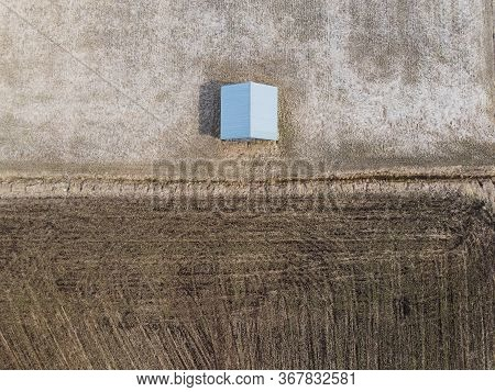 An Above View Of A Barn House By The Fields At The Northern Finland. The Fields Are Waiting For The
