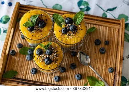 Fresh Mango Smoothie With Blueberries. Healthy Diet Nutrition. Vegetarian Healthy Food. Homemade Chi
