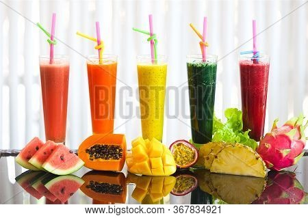 Tropical Fruit Smoothie, On A Table In Glasses Of Watermelon Neck With Papaya Pineapple Mango And Pa
