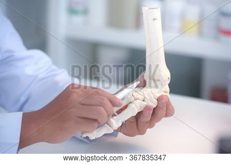 Orthopedic Doctor In His Office With The Patient And The Foot Model Orthopedic Doctor In His Office