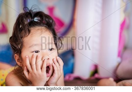 A Cute Little Girl With An Open Mouth Shocked With The Latest News. The Child Learns Something New A