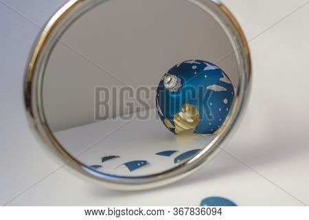 The Broken Blue Christmas Ball Is Reflected In The Mirror. Metaphor Or Symbol Of Shattered Hopes, Lo
