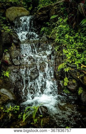 Landscape. Small Cascade Waterfall. Nature Background. Fast Water Flow. Stream With Stones In Tropic