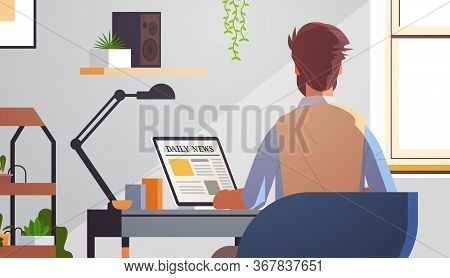 Businessman Sitting At Workplace Reading Daily News Articles On Laptop Screen Online Newspaper Press