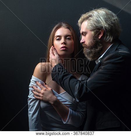 Sensual Couple In Love On Black Isolated. Intimate Moments For Lovers. Sensual Couple Enjoying Intim