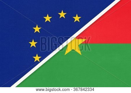 European Union Or Eu And Burkina Faso National Flag From Textile. Symbol Of The Council Of Europe As