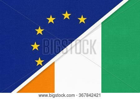 European Union Or Eu And Ivory Coast National Flag From Textile. Symbol Of The Council Of Europe Ass