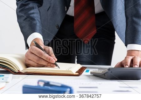 Close-up Businessman Hand Writing To Do List In Diary At Desk. Financial Expertise And Consulting. M