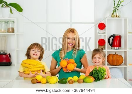Superfood Family Concept. The Happy Smiling Caucasian Healthy Family In Kitchen Preparing Breakfast