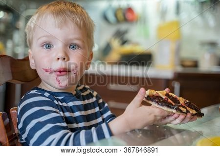 Little Cute Blond Boy Bully Without Permission Of His Mother Broke Off Piece Of Berry Pie And Eats I