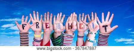 Children Hands Building Word Freiheit Means Freedom, Blue Sky