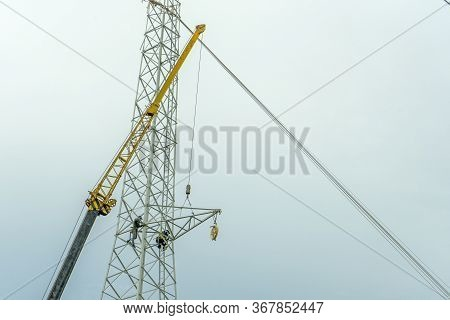 Electrical Engineer Or Electrician Use The Crane To Lift To Repair The High Voltage Pole, Light Pole