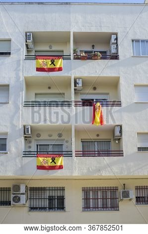 Badajoz, Spain - May 18th 2020: Spanish Flags With A Black Ribbon Hangs Over Balconies. Tribute To C