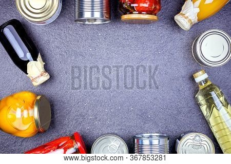 Donations Food With Canned Food On The Table With Copy Space. Various Canned Vegetables, Meat, Fish