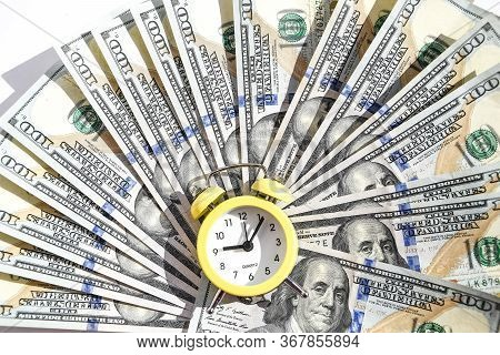 Business Financial Ideas Concept With Banknotes Stack And Alarm Clock Background With Free Copy Spac
