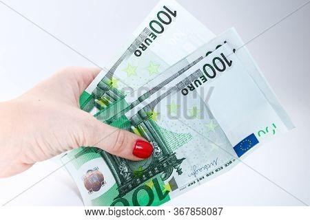 Euro Bills In Female Hands. Euro Cash Background On White, Fan Of 100 Euros, One Hundred Euros