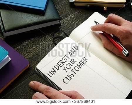 Businessman Writes Understand Your Customer In The Notepad.