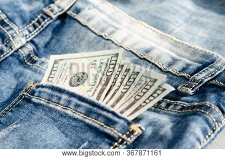 100  Dollars On The  Back Pocket Jeans  . Concept Of Prostitution  Or  Sexual Exploitation  .