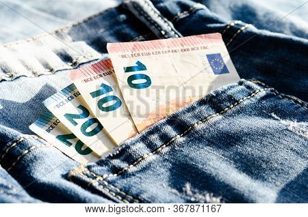 10 And  20  Euros In The Back Pocket Jeans  . Concept Regarding Poverty And The Minimum Wage .