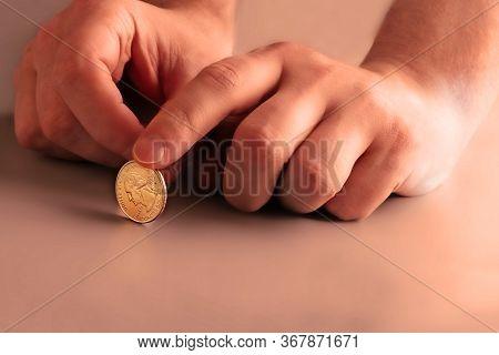 Men Hand Hold A Quarter Dollar. American Money. Orange Gradient
