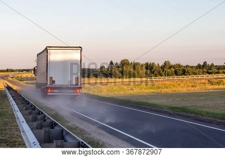 Emergency Braking Of A Loaded Truck On Dry Asphalt. Safety Concept And Stopping Distance With Abs, C