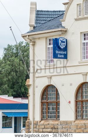 Winburg, South Africa - March 1, 2020: Part Of An Historic, Old, Bank Building, In Winburg. The Logo