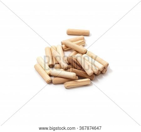 Wooden Dowel For Assembling Furniture On A White Background, Isolate, Close-up