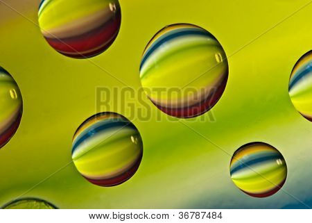 Multi-colored Drops Of Water.