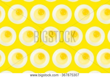 Pattern Of Raw Eggs In Bowls On Yellow Background. Healthy Food And Cooking At Home Concept.