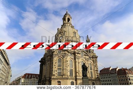Coronavirus In Dresden, Germany. Frauenkirche ( Literally Church Of Our Lady). Covid-19 Sign. Concep